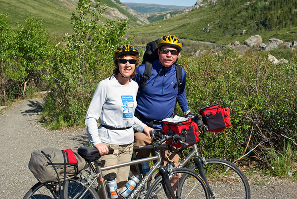 Backroads Multisport Adventure to Alaska, 26 mile bike trip from the Denali National Park Visitor center to Savage River and back.  Mike and Sue with Savage river canyon in background.